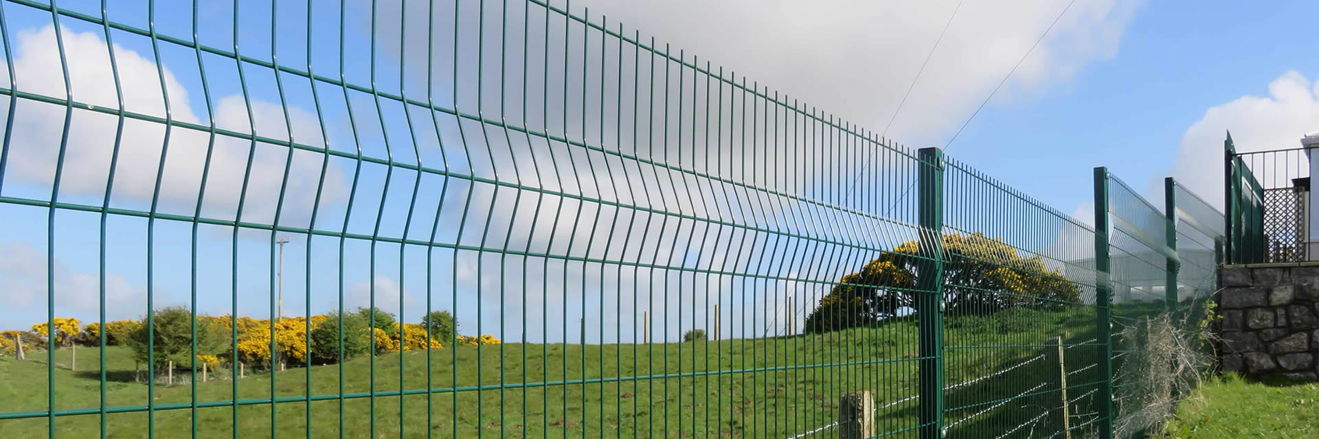 Green PVC coated 3D fence is used in a sloping stone earth.