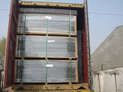 2D fence panels were packed in pallets and enveloped by plastic film stored in freight car waiting for delivery.