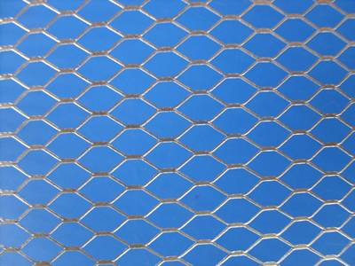 A detailed drawing of galvanized expanded metal with hexagon openings.
