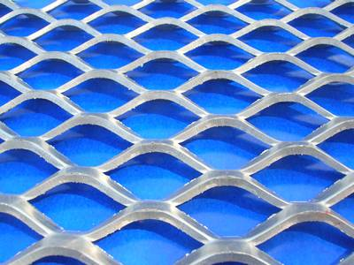 Part of standard expanded metal being put on a blue background