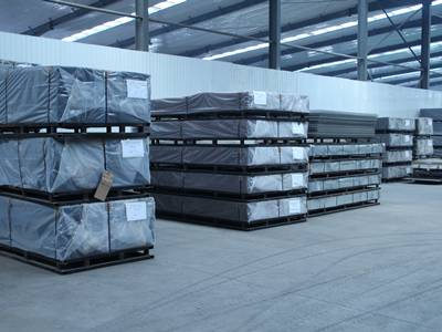 pallets with panels inside warehouse.