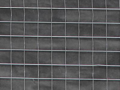 A part map of welded wire lath used on wall, with black water resistant paper behind the lath.